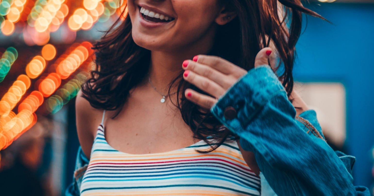 girl smiling in striped top