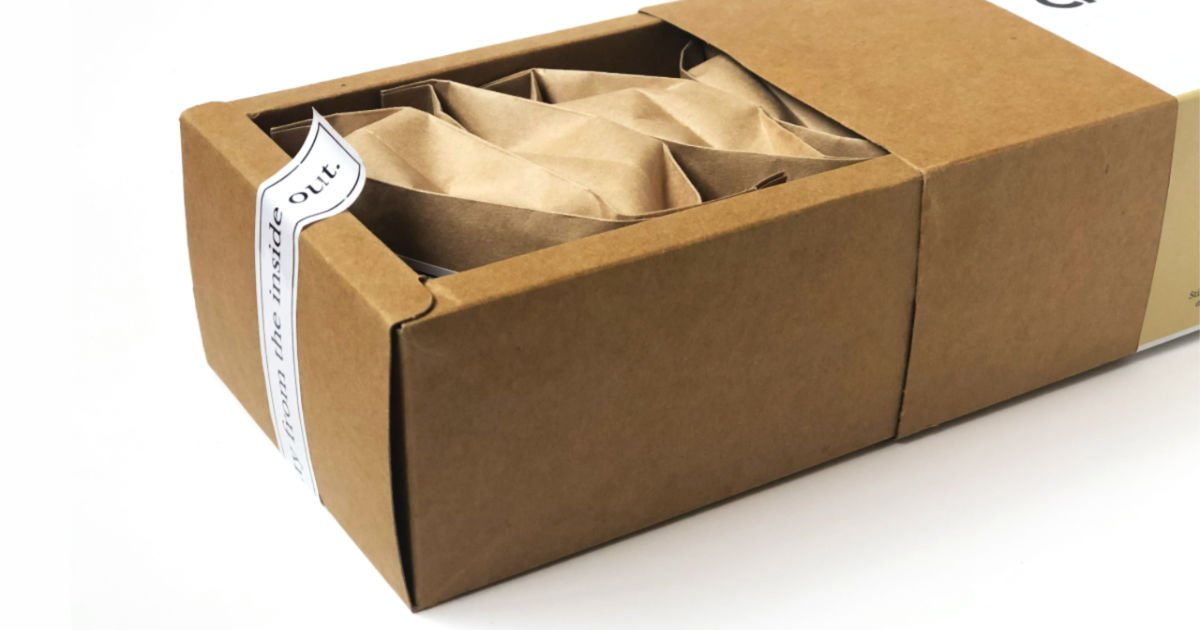 a brown package opened on a white table