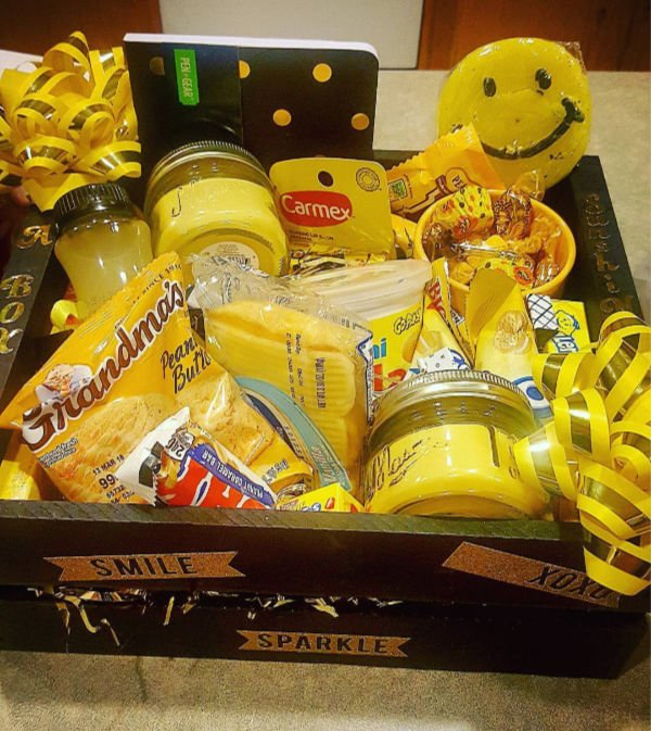 black box with yellow things, outside says smile and sparkle