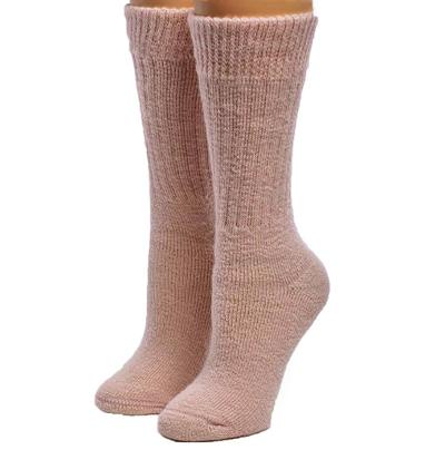 pink pair of warm alpaca wool socks, gift idea for girl in college