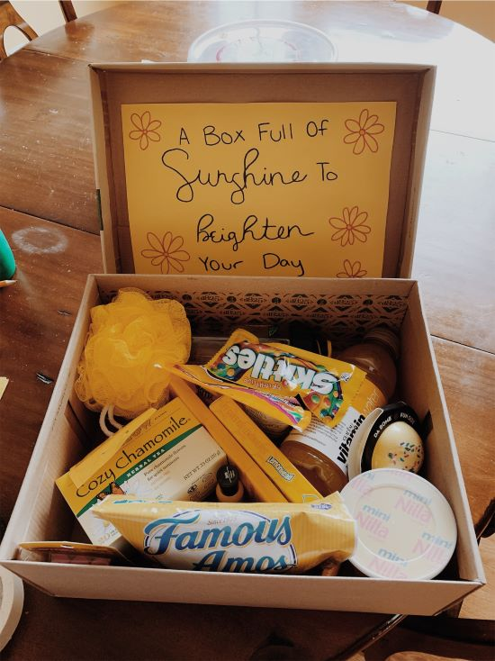 cute box to brighten your day with a yellow loofah, cookies, and cozy chamomile tea