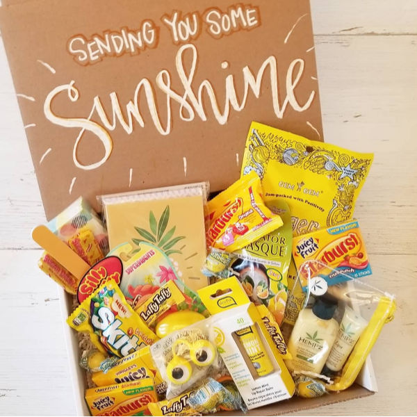 package with yellow thing that say sending you some sunshine