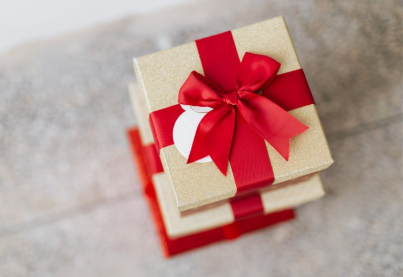 college student Christmas gift wrapped with a red bow