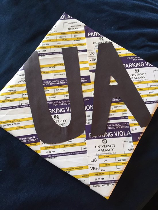 last minute grad cap decorated with parking tickets