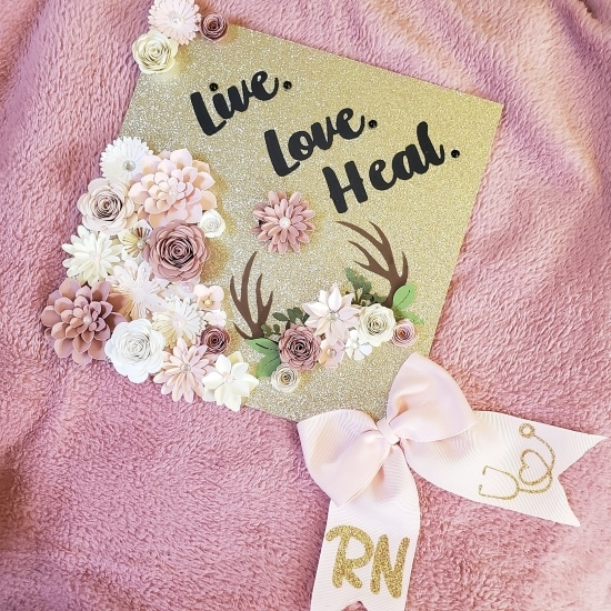 live. love. heal. gold and flowers decorated RN grad cap topper idea