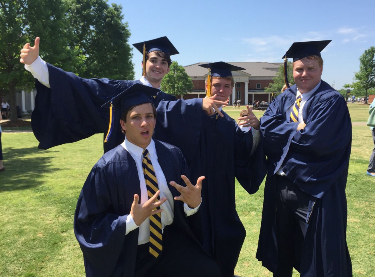 group of boys in funny poses at high school graduation